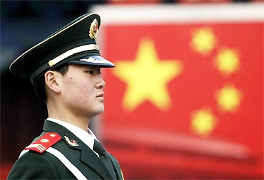 A paramilitary policeman practises during a daily training session at the Forbidden City in Beijing