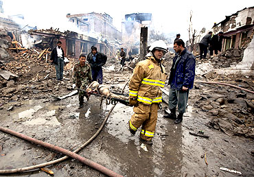Rescue staff carry a victim from the site of the blast