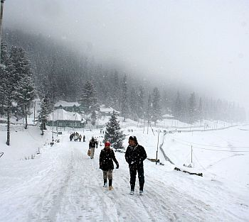 Tourists enjoy the season's second snowfall