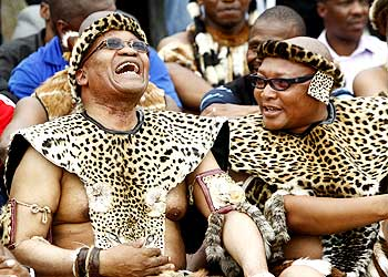 South African President Jacob Zuma (Left) shares a joke with a family member during his traditional wedding to Tobeka Madiba, his fifth wife