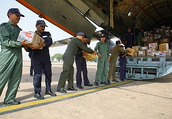 Indian Air Force personnel load relief assistance for Sri Lanka onto a transport aircraft at the airport in New Delhi