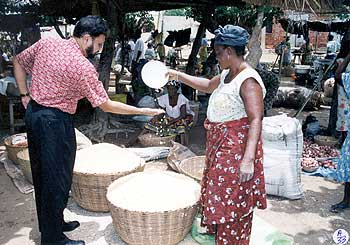 Dr Amit Roy visiting a market in Togo