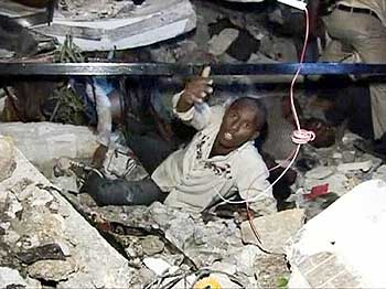 A man calls for help while being trapped among the debris at the Port-au-Prince University.