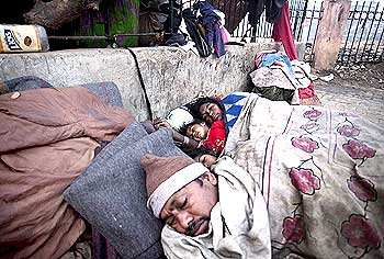 Homeless people sleep on a chilly morning in Delhi.