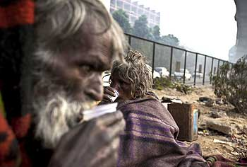 A man enjoys a cup of tea on the streets of Delhi.