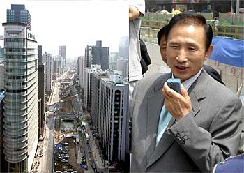 Picture dated March 18, 2005 shows construction work in progress along the Cheonggyecheon stream in Seoul. (Right) Lee, then Mayor, coordinates with staff on site