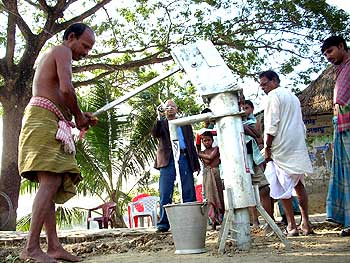 Kabir Suman supervises the sinking of a tubewell in a village
