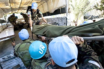 MINUSTAH (United Nations Stabilization Mission in Haiti) peacekeepers load an injured person into a truck in Port au Prince