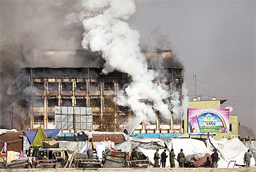 Smoke rises from a shopping mall after a Taliban attack in Kabul