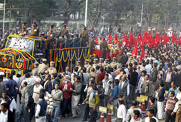 Thousands follow the body of Jyoti Basu during a procession in Kolkata on Tuesday