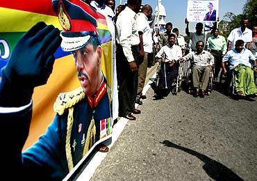 Physically disabled former soldiers and veterans attend a rally in the streets to support presidential candidate Sarath Fonseka in Colombo
