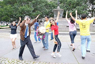Youths dance to the beats of traditional Punjabi-folk Bhangra in New York