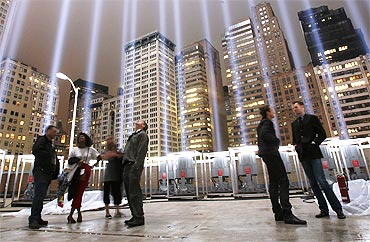 Onlookers stand inside of the 'Tribute in Lights in Manhattan' on the eighth anniversary of the attack on the World Trade Center in New York on September 11, 2009
