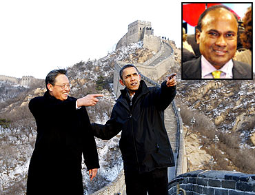Obama at the Great Wall of China with Chinese diplomat Zhou Wenzhong and (inset) Narender Reddy