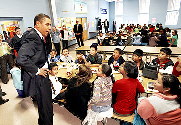Obama greets third and fourth grade students at a school in Maryland