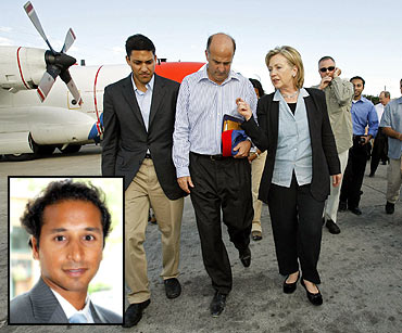 Clinton with US Aid Administrator Rajiv Shah at the Port-au-Prince airport and (inset) Dino Teppara