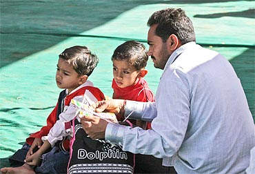 Harilal Kapdi with his children at the prayer venue