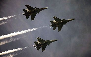 Three planes in formation fly over Rajpath