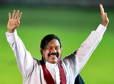 Rajapaksa waves to a crowd at his political party's convention in Colombo