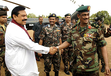 File photo shows Rajapaksa shaking hands with Army Commander Lieutenant General Sarath Fonseka