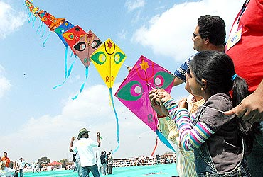 Kites attract children during International Kite festival at the Bangalore Palace grounds