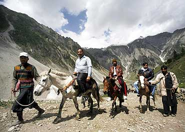 Pilgrims ride ponies to the Amarnath shrine