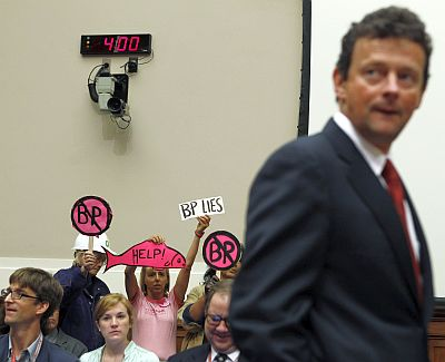 British Petroleum CEO Tony Hayward walks past protesters as he arrives to testify about the BP oil spill in the Gulf of Mexico at the House Energy and Commerce Committee on Capitol Hill on June 17, 2010.