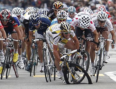 A pack of riders, including HTC Columbia's team rider Mark Cavendish (3rd R), crash during their sprint next to the finish line in the fourth stage of the Tour de Suisse from Schwarzenburg to Wettingen on June 15, 2010.