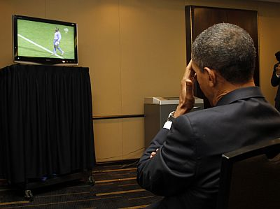 US President Barack Obama watches a live telecast of the 2010 World Cup soccer match between the US and Ghana during a short break between bilateral meetings with South Korea's President Lee Myung-bak and China's President Hu Jintao at the G20 Summit in Toronto on June 26, 2010.