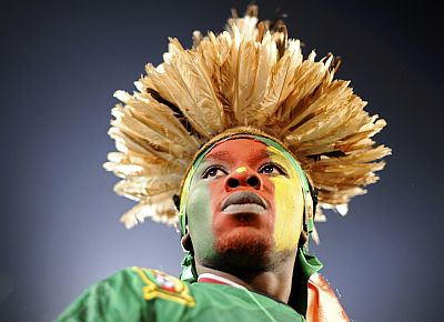 A fan awaits the start of a 2010 World Cup Group E soccer match between Cameroon and Denmark at Loftus Versfeld stadium in Pretoria on June 19, 2010.