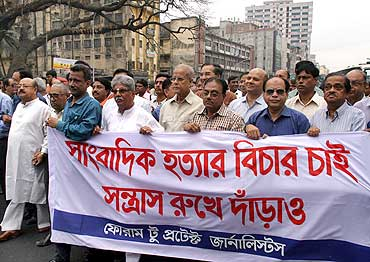 An organisation of editors and journalists stages a silent march in Dhaka