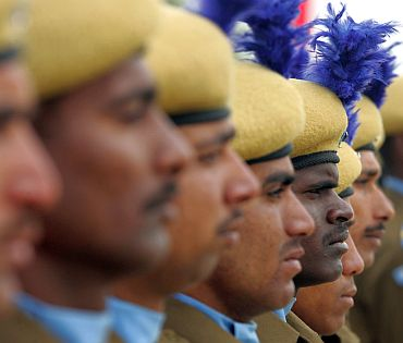 CRPF recruits stand at attention during their passing out parade in a camp in Humhama on the outskirts of Srinagar