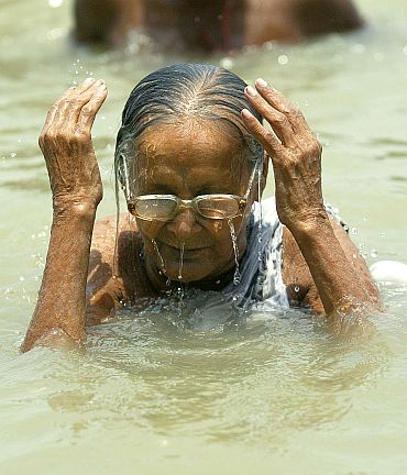 Kamala Sundari Paul, 95, takes a dip in river Hooghly in Kolkata