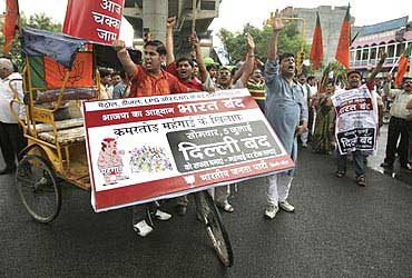 BJP activists shout slogans during a strike against the hike in fuel prices in New Delhi