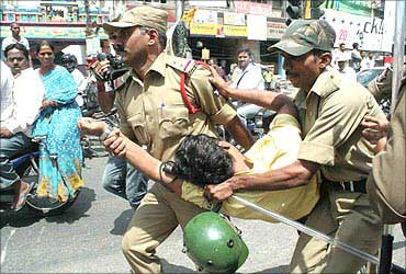Police try to foil a demonstration during the bandh