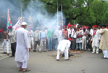 SP workers burn an effigy of the PM