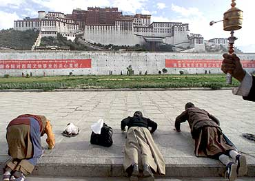 Tibetan women pray at the Potala Palace in Lhasa, Tibet