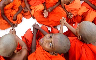 Monks attend a special prayer to mark Buddha Jayanti in Bhopal