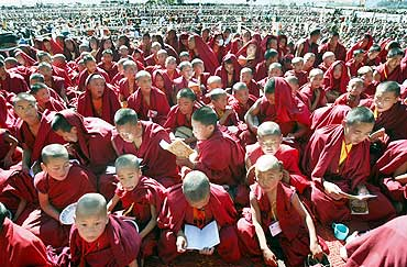 Buddhist monks listen to the Dalai Lama in Tawang