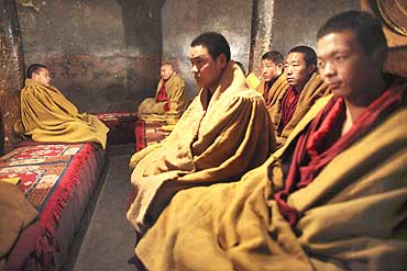 Tibetan monks inside a monastery