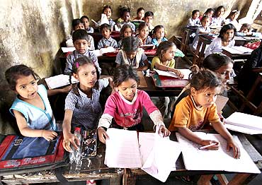 Students study in a government-run school at a slum