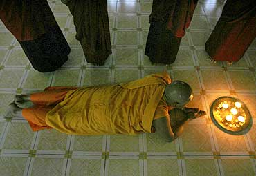 A Tibetan monk prays at a monastery in Siliguri