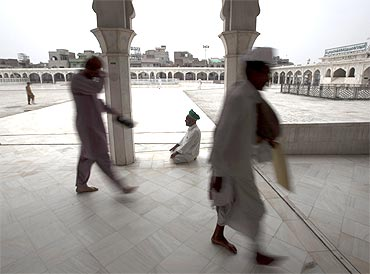 A man prays in the courtyard of the Data Darbar Sufi shrine in Lahore