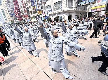 Performers dressed as terracotta warriors parade in Shanghai