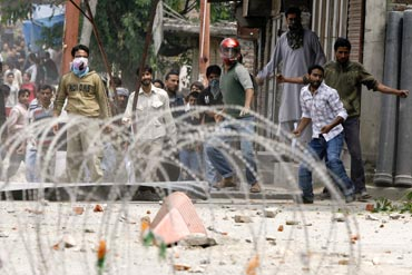 Kashmiri protesters clash with police during a protest against the death of a youth in Srinagar on June 12