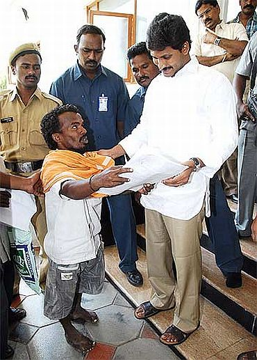 File photo shows Jagan meeting a supporter outside his residence