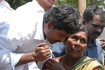File photo of Jagan speaking to flood victims in Andhra Pradesh