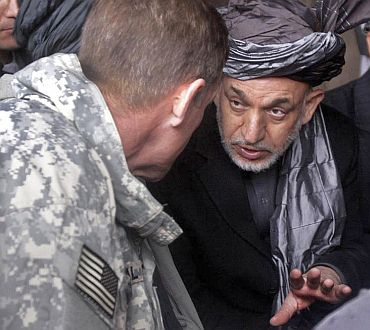 Hamid Karzai talks to then Commander of US troops in Afghanistan Gen McCrystal at Nawa district