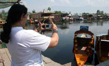A lone tourist clicks a picture in Srinagar