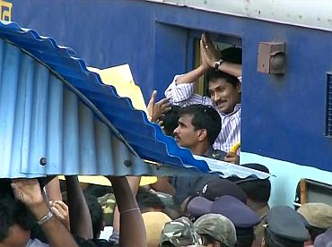 Jagan greets supporters before disembarking at Loddaputti